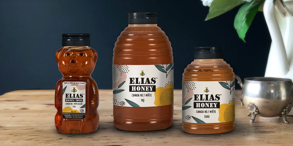 Elias honey squeeze bottles on wood table