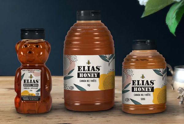 Elias honey squeeze bottles on wood table