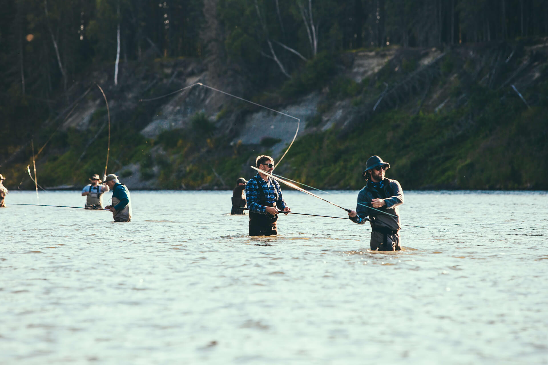 men flyfishing on river
